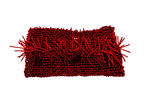 ECLECTIC - Clutch in Neoprene yarn. Hand knitted.